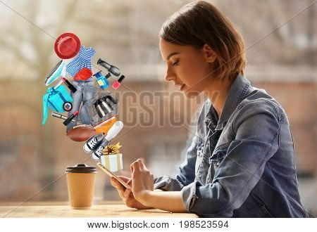 Young woman using smartphone for browsing internet store in cafe. Online shopping concept
