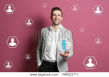 Young man and employees icons on color background. Concept of human resources management