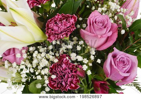 closeup of pink roses and carnations background