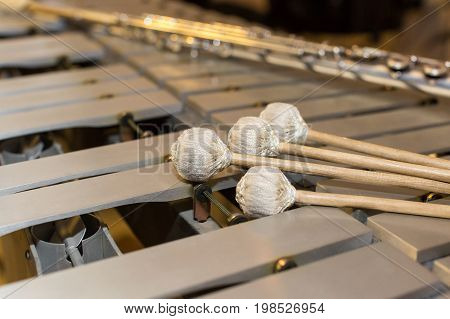 xylophone, music and chromatic instrument concept - closeup on wooden bars with four mallets, glockenspiel, marimba, balafon, semantron, pixiphone, education and orchestra concert usage