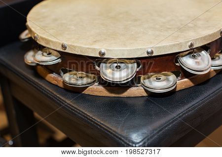 drumhead or drum skin, percussion instrument concept - beautiful closeup on orchestral tambourine, ensembles and jazz concerts of classical music, turkish folk, greek, italian, samba, pop and rock