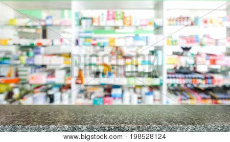 Marble tabletop with blurred of medicine background use for drugs or products display