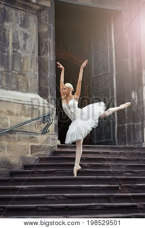 Shot of a graceful blonde haired ballerina dancing on the stairs of an old castle beauty grace elegance concept.