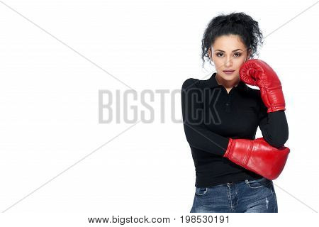 Attractive Hispanic young woman smiling joyfully wearing boxing gloves posing confidently on isolated white background copyspace motivation leadership femininity confidence business sports.