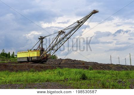Excavator machine at excavation earthmoving work in quarry.