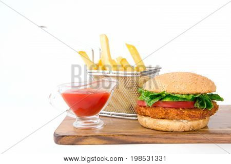 Set Of Hamburger And French Fries With Sause On Wooden Cutting Board On White Background