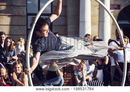 LUBLIN, POLAND- 29 july 2017- street performer dancing wit the wheel at Carnaval Sztukmistrzow Festival placed in city space of Lublin dedicated to theatre, circus and street art
