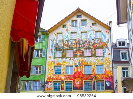 Lucerne, Switzerland - May 02, 2017: Fairy painting on the wall of old house in Lucerne, Switzerland on May 02, 2017