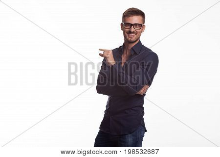 Young jocular man portrait of a confident businessman on a gray background. Ideal for banners, registration forms, presentation, landings, presenting concept.