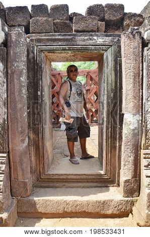 Traveler thai people travel visit and shooting photo at archaeological site Wat Phu or Vat Phou 10th century is a ruined Khmer Hindu temple in Champasak Laos