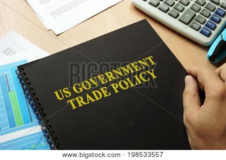 US government trade policy on a table.