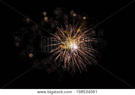 Golden orange amazing fireworks isolated in dark background close up with the place for text, explode