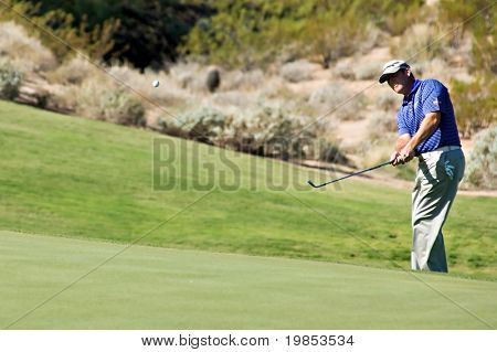 SCOTTSDALE, AZ - OCTOBER 22: Bubba Watson  chips onto the green in the Frys.com Open PGA golf tournament on October 22, 2009 in Scottsdale, Arizona.