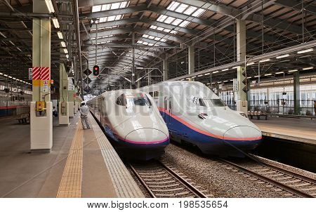 NIIGATA JAPAN - JUNE 01 2017: Double-decked E4 and E2 type high-speed trains on Niigata station Japan. Operated by East Japan Railway Company (JR East) on Joetsu Shinkansen line