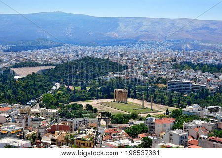Panoramic view of Athens and the famous temple of Olympian Zeus from the Acropolis on a summer sunny day.