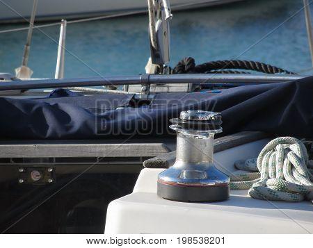 Bollard and mooring ropes on sailing boat bow