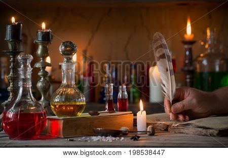 hand magic potion ancient books and candles