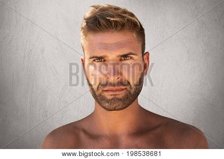 Close Up Portrait Of Good-looking Male With Dark Eyes, Bristle And Trendy Hairdo Being Naked, Lookin