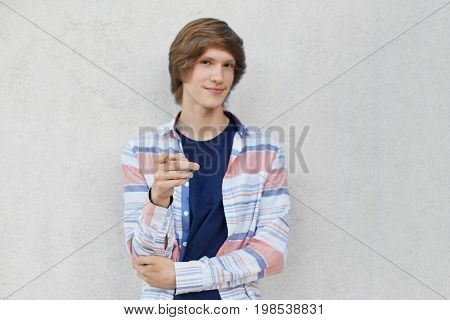 Confident Teenage Boy With Stylish Hairdo Wearing Casual Shirt Pointing With His Finger At Camera Wh