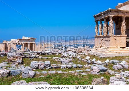 Ancient Acropolis Erechtheion view of the north side of the Parthenon with caryatids and Athens Greece.