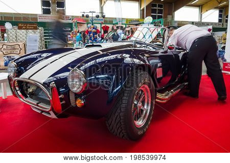 PAAREN IM GLIEN GERMANY - MAY 23 2015: Car preparation for the show. AC Cobra (replica). The oldtimer show in MAFZ.