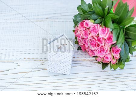 Ring in the box and bouquet. Place for the inscription. Concept love statement valentine's day.
