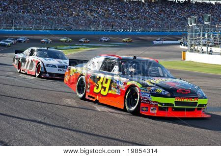 AVONDALE, AZ - APRIL 10: Race winner Ryan Newman (#39) leads a group of cars out of turn one at the Subway Fresh Fit 600 NASCAR Sprint Cup race on April 10, 2010 in Avondale, AZ.