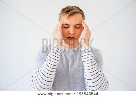 Young man is suffering from a headache