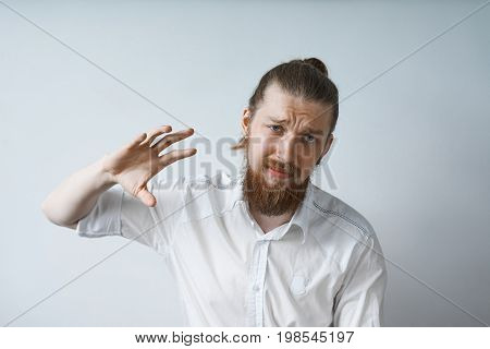 Human facial expressions emotions feelings attitude and reaction. Waist up studio portrait of bearded young Caucasian office worker in white shirt gesturing looking indifferent saying: Whatever