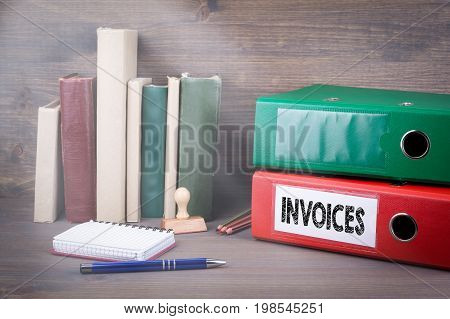 Invoices. Binder on desk in the office. Business background.