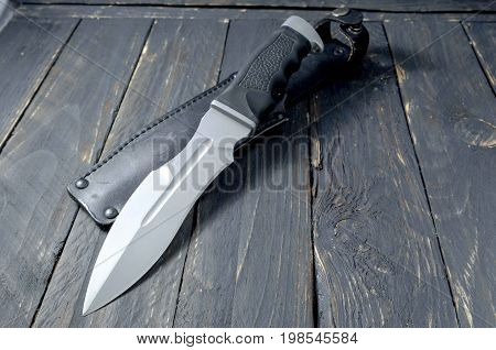 Military Knife On Black Background.