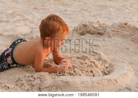 Child destroy sand castle beach summer destruction playing childhood.