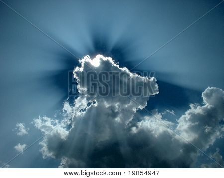 Sunlight beaming out from behind clouds,