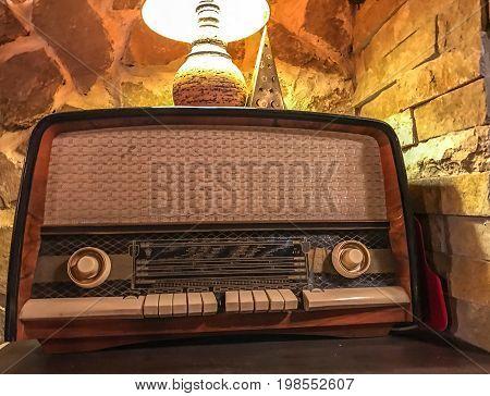 Old retro vintage radio and a romantic lamp