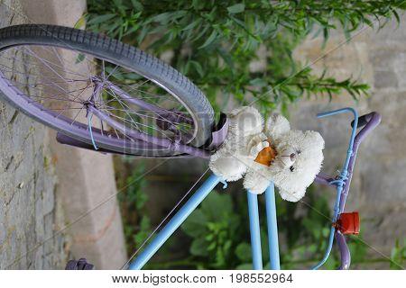 A beautiful pinky bike at a street