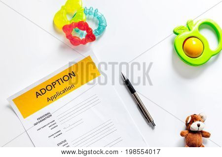 Adoption application on white background top view.