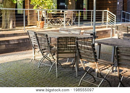 Wooden chairs and table in cafeteria outdoors