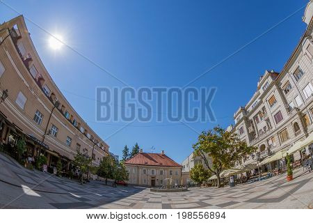 NOVI SAD SERBIA - JULY 30 2017: View of one square and old buildings located behind at the Mary Church. One of the cities designated as the European capital of culture in 2021.
