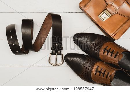 classic men's accessories. Shoes with handbag and belt