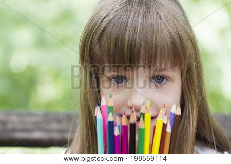 She Loves To Draw And Color With Crayons