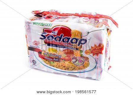 Selangor Malaysia: August 4 2017 - Malaysia famous instant noodle Mi Sedaap fried noodle on white background.