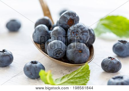Ripe Blueberries In A Tablespoon Of Closeup.