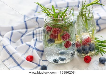 Berries And Tarragon In Jar With Sparkling Ice Water.