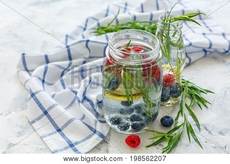 Berries And Tarragon In Jar With Sparkling Water.
