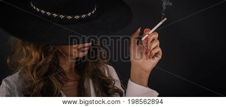 Portrait Of Sexy Elegant Lady Woman With Hat Smoking Cigarette