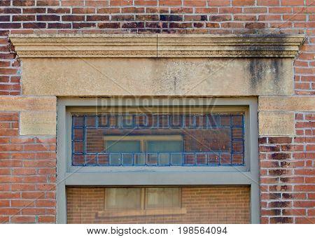 Nineteenth century limestone window lintel in a brick building