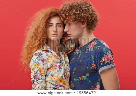 Waist Up Portrait Of Passionate Young Couple In Love Posing Isolated In Studio, Standing Close To Ea