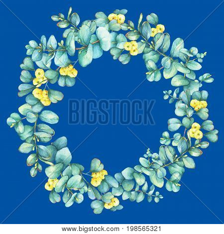 Green floral round wreath with a branch of silver-dollar eucalyptus cordata and Eucalyptus websteriana (Heart-leafed), isolated on blue background. Watercolor hand drawn painting illustration.