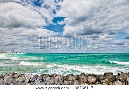 Miami Seascape with clouds and amber sea in south beach or miami beach