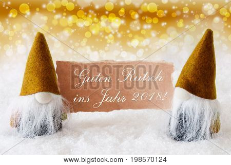 Christmas Greeting Card With Two Golden Gnomes. Sparkling Bokeh And Noble Background With Snow. German Text Guter Rutsch Ins Jahr 2017 Means Happy New Year 2018